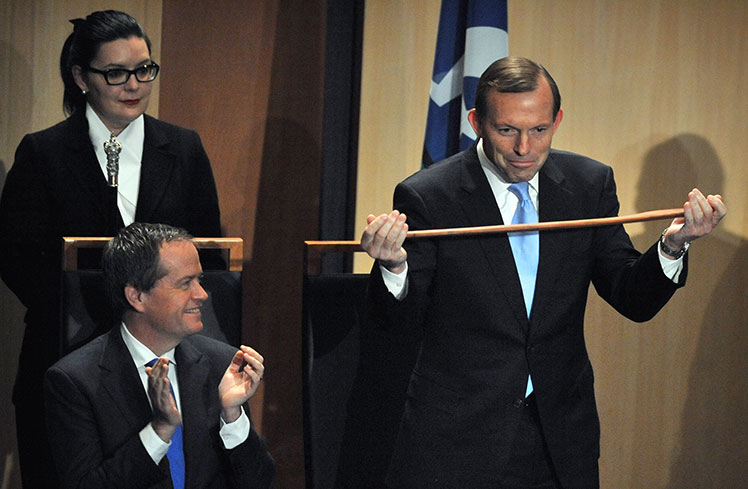 Sparring partners ... opposition leader Bill Shorten (l) congratulates Prime Minister Tony Abbott (right) on the receipt of an Aboriginal fighting boomerang at the opening of the 44th Parliament in Canberra.