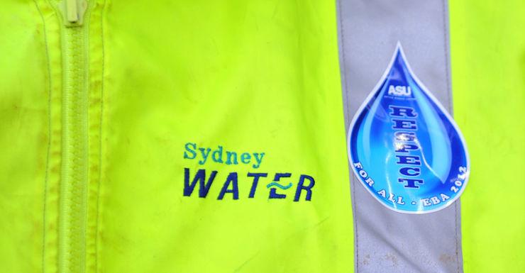 A worker wearing a Sydney Water uniform