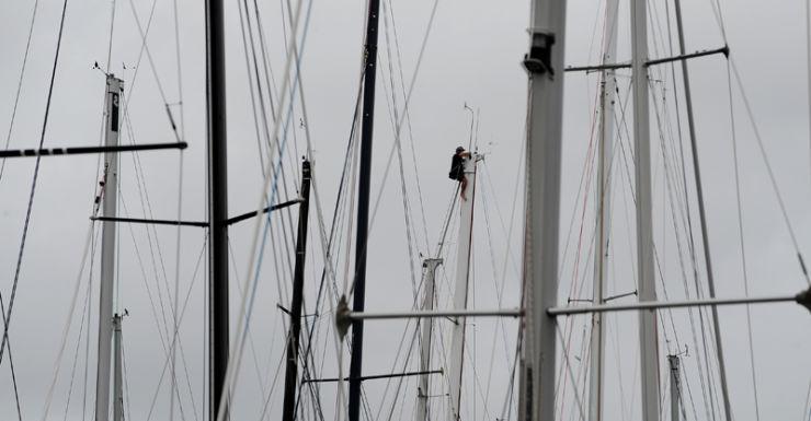 A crew member climbing a mast in Sydney