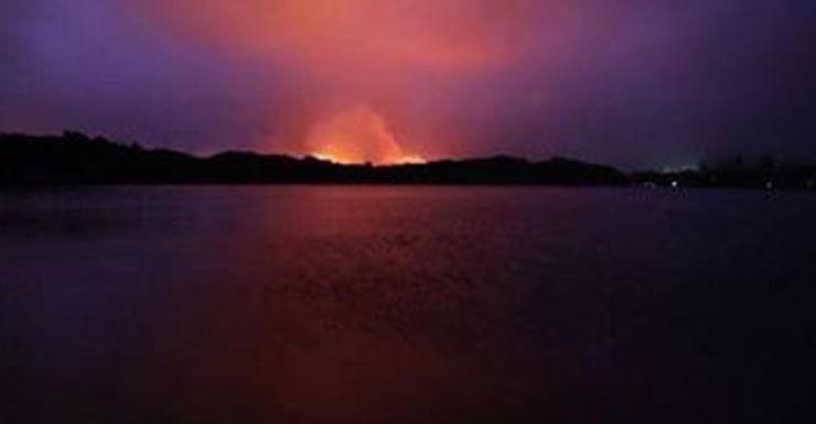 a fire burning near Lennox Head