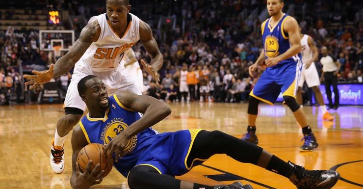 Draymond Green of the Golden State Warriors grabs a loose ball against the Phoenix Suns.