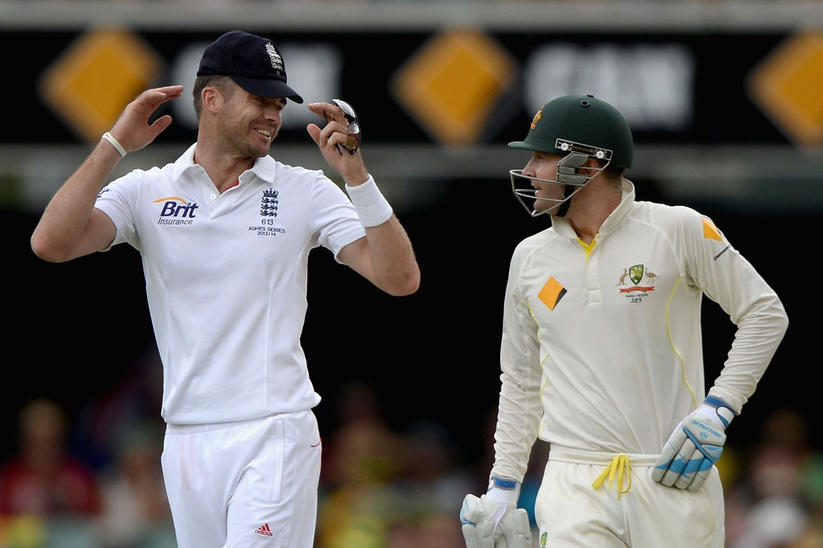 James Anderson shares a moment with Michael Clarke.