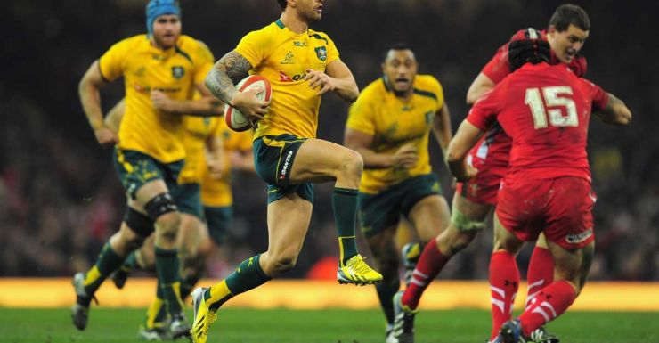Wallaby Quade Cooper makes a break during the win over Wales.