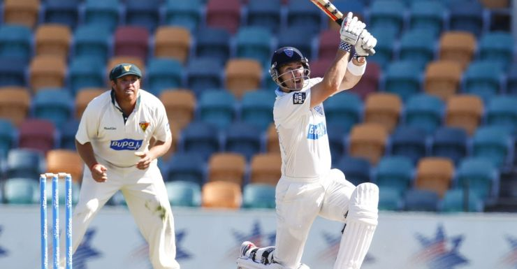Peter Nevill hits out for NSW against Tasmania.