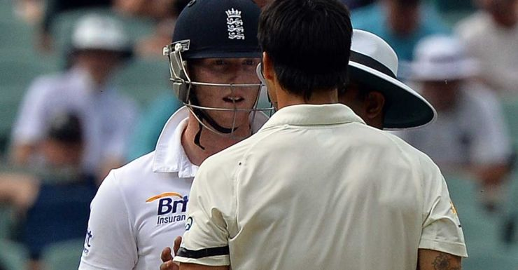 Ben Stokes and Mitchell Johnson are separated by the umpire.
