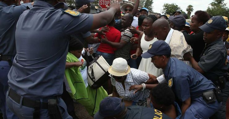 A woman is knocked down in the crush to see Mandela.