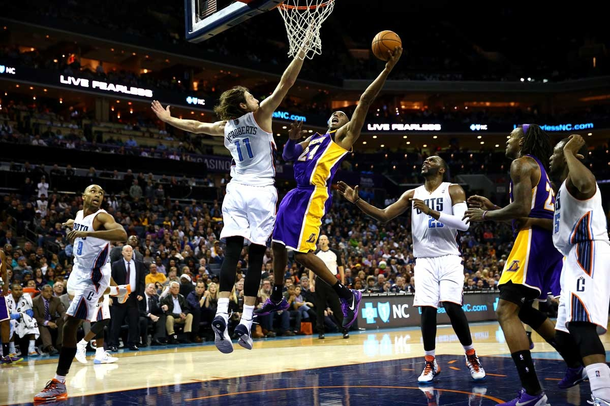 Kobe Bryant drives to the basket against the Charlotte Bobcats.