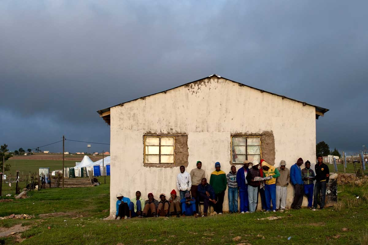 People stand nearby the house of Nelson Mandela in Qunu, where his coffin has arrived.
