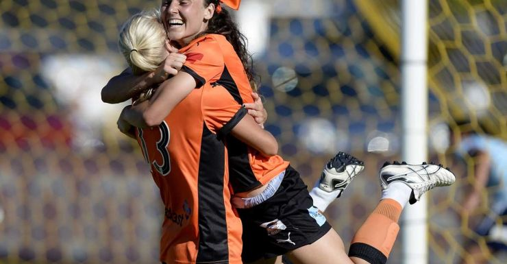 Hayley Raso celebrates with Tameka Butt after equalising for the Roar.