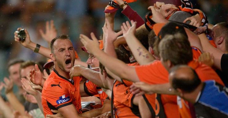 Ivan Franjic of the Roar celebrates with fans after scoring against Sydney.