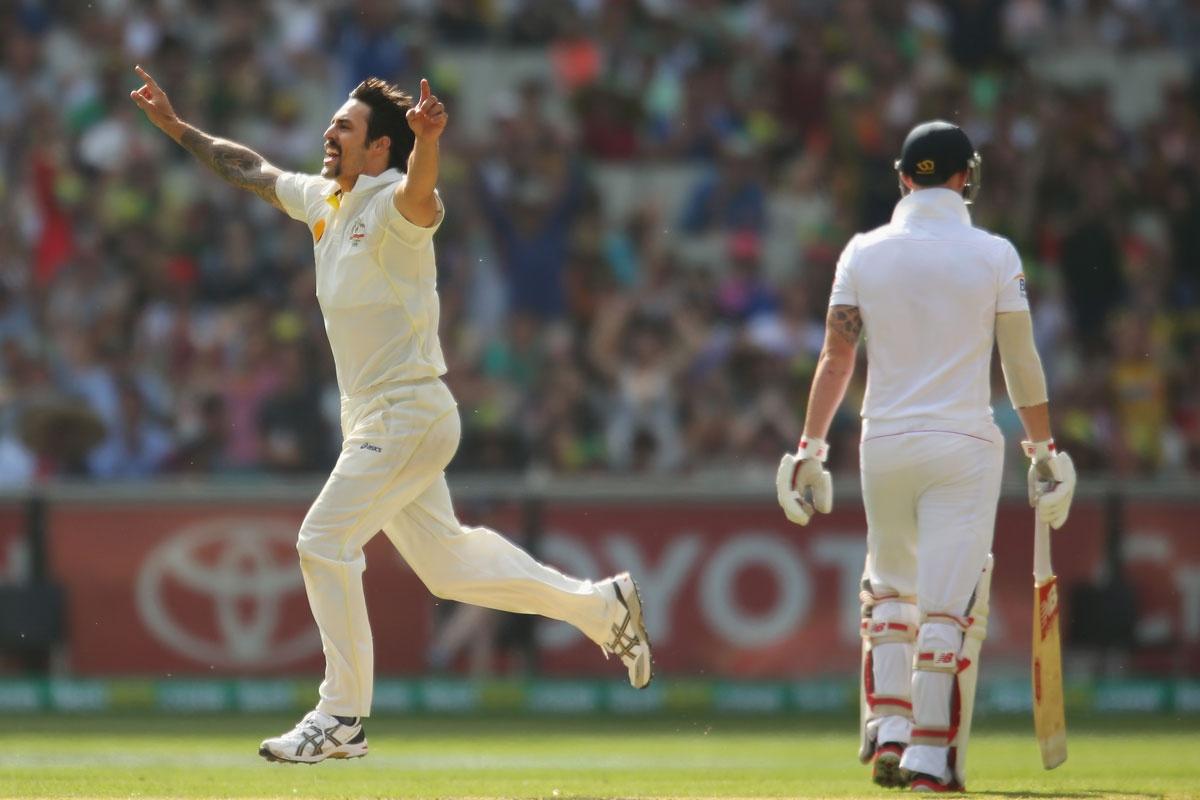 Mitchell Johnson celebrates the wicket of Ben Stokes.