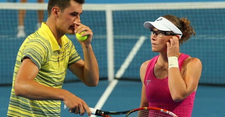 Tomic and Stosur during their mixed doubles against Canada.