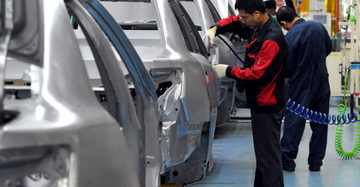 File photo of workers building cars at the Toyota plant in Melbourne