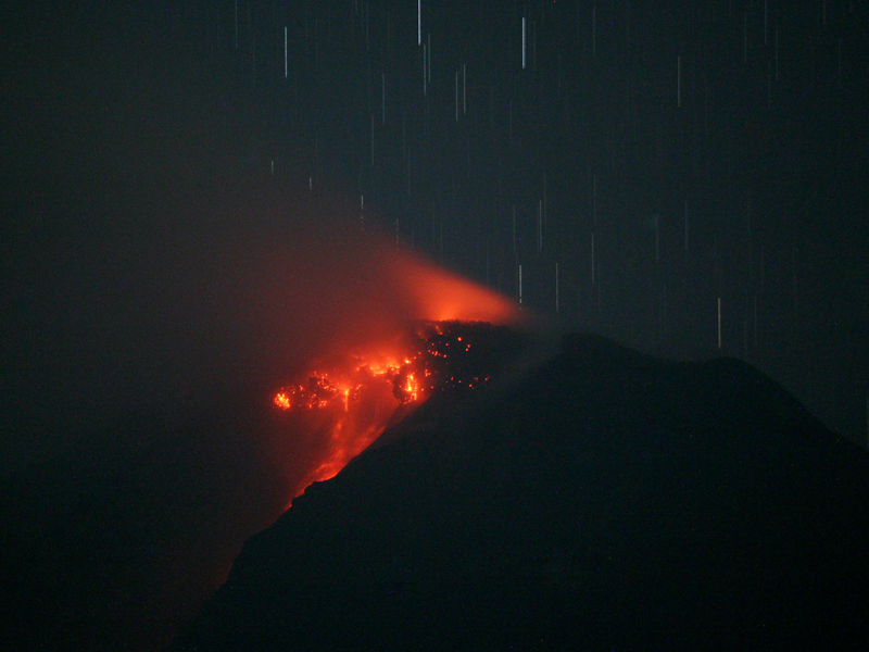 Lava glows at the crater of Mount Sinabung in Indonesia