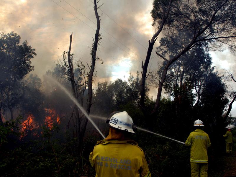 Firefighters fight bushfires on North Stradbroke Island