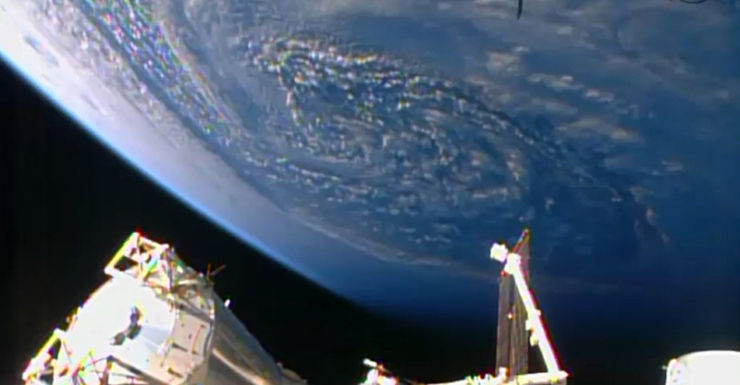 An unmanned cargo ship arrives at the International Space Station