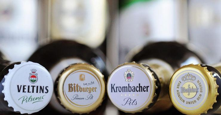 Bottles of breweries Krombacher, Warsteiner, Veltins and Bitburger