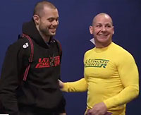 Team Australia trainer Jon Chaimberg (right) with his regular student, Team Canada's Chad Laprise.