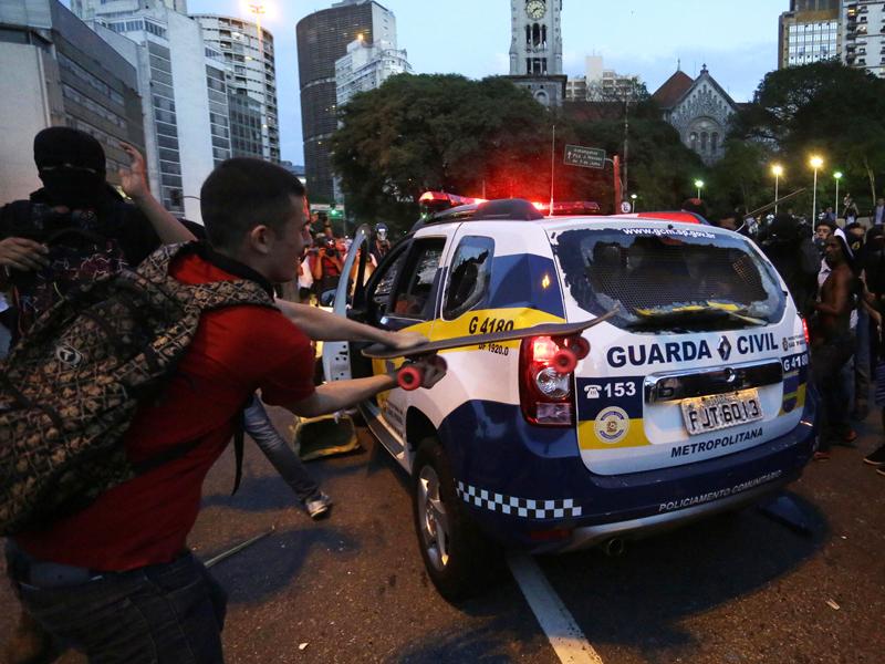 Demonstrators attack a municipal police in Sao Paulo, Brazil