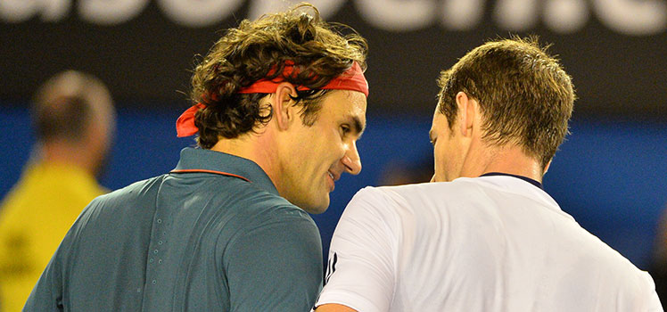 Roger Federer (left) and Andy Murray embrace after their Australian Open quarter-final clash.
