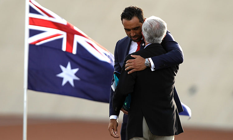 Australian of the Year, Adam Goodes, embraces the Senior Australian of the Year, Fred Chaney.