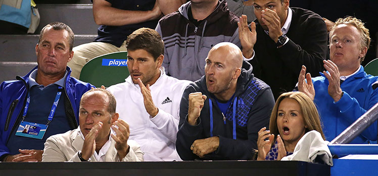 Ivan Lendl (left) is impassive as Andy Murray's girlfriend, Kim Sears (bottom right), roars her approval.