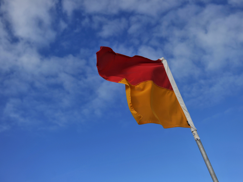 Stock photo of a lifeguard flag
