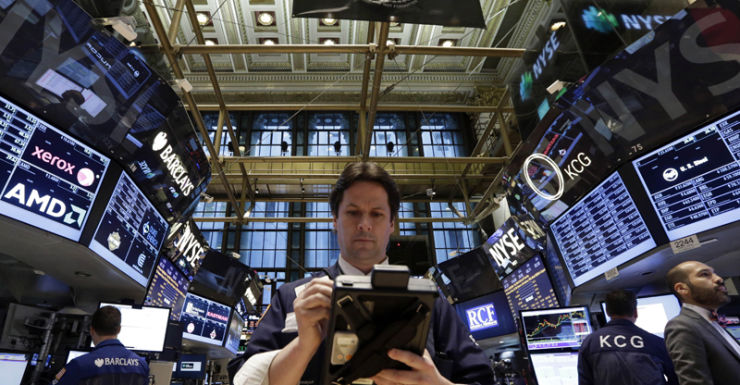 A trader on the floor of the NYSE