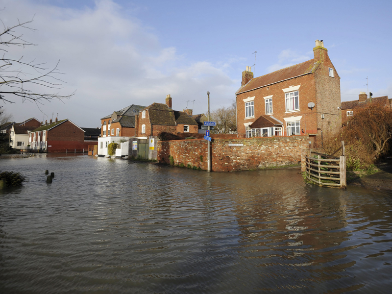 A road is turned into a river in the town of Tewkesbury in England