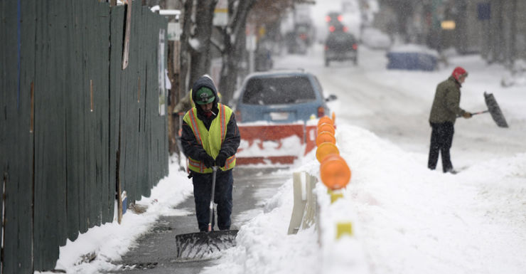 A man shovels the snow, New York, USA
