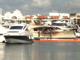 Damaged yachts at a Gold Coast marina