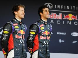 Formula One driver's Sebastian Vettel (L) and Daniel Ricciardo