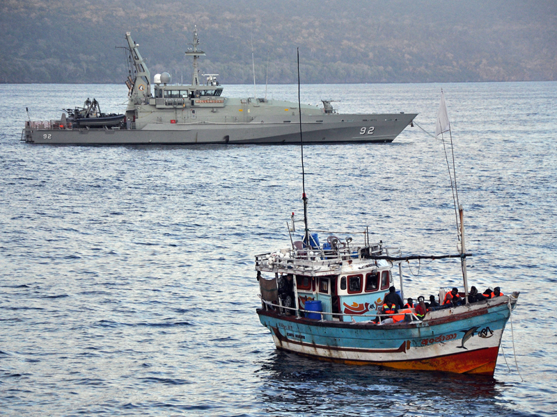 A supplied file photo of the navy intercepting a refugee boat