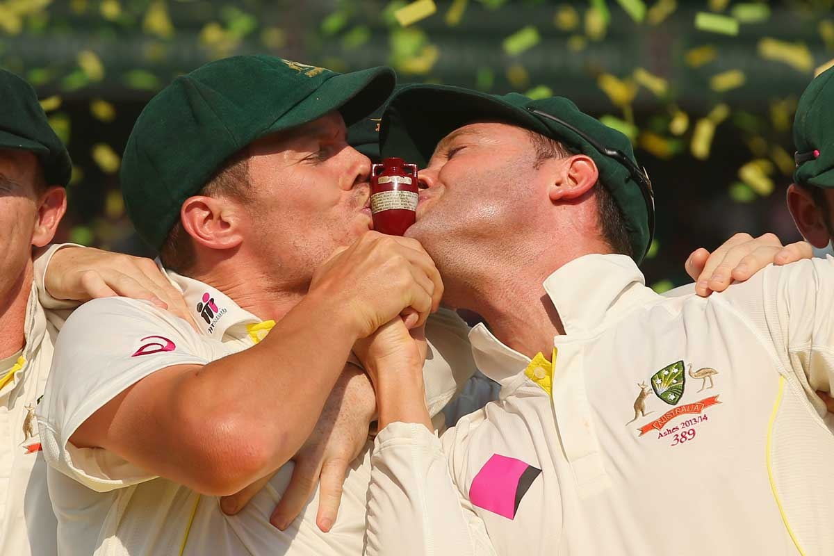 The sweet taste of success: Peter Siddle, Michael Clarke and the urn.