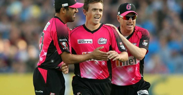 Steve O'Keefe of the Sixers is congratulated after dismissing Michael Klinger.
