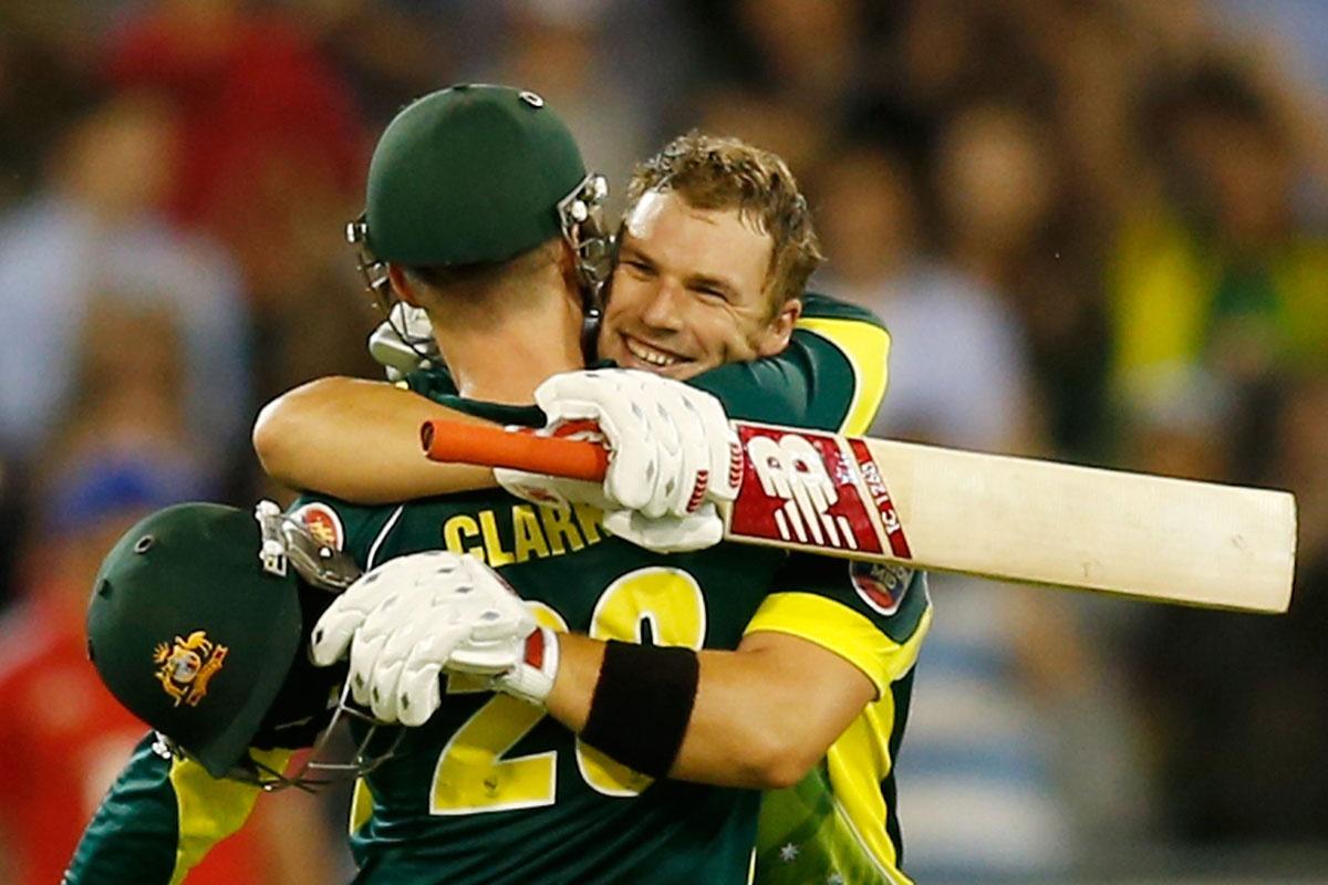 Aaron Finch is congratulated by skipper Michael Clarke.