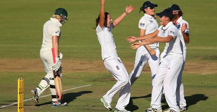 England star Kathryn Cross celebrates the wicket of Jess Cameron.