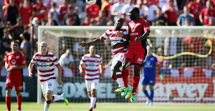 An aerial duel between Youssouf Hersi (left) and Bruce Djite.