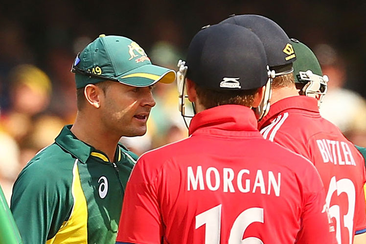 Clarke gets close and personal with the English batsmen.