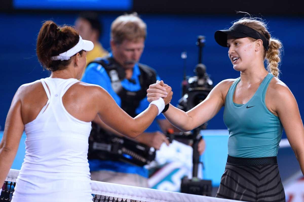 Casey Dellacqua (left) congratulates Canada's Eugenie Bouchard.