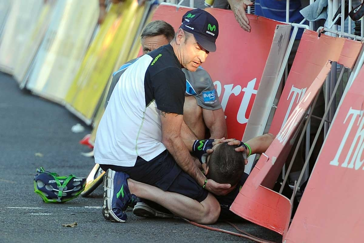 Giovanni Visconti is assisted after his crash.