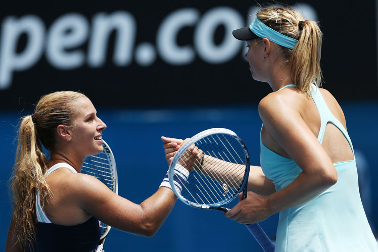 Dominika Cibulkova (left) after defeating Maria Sharapova.