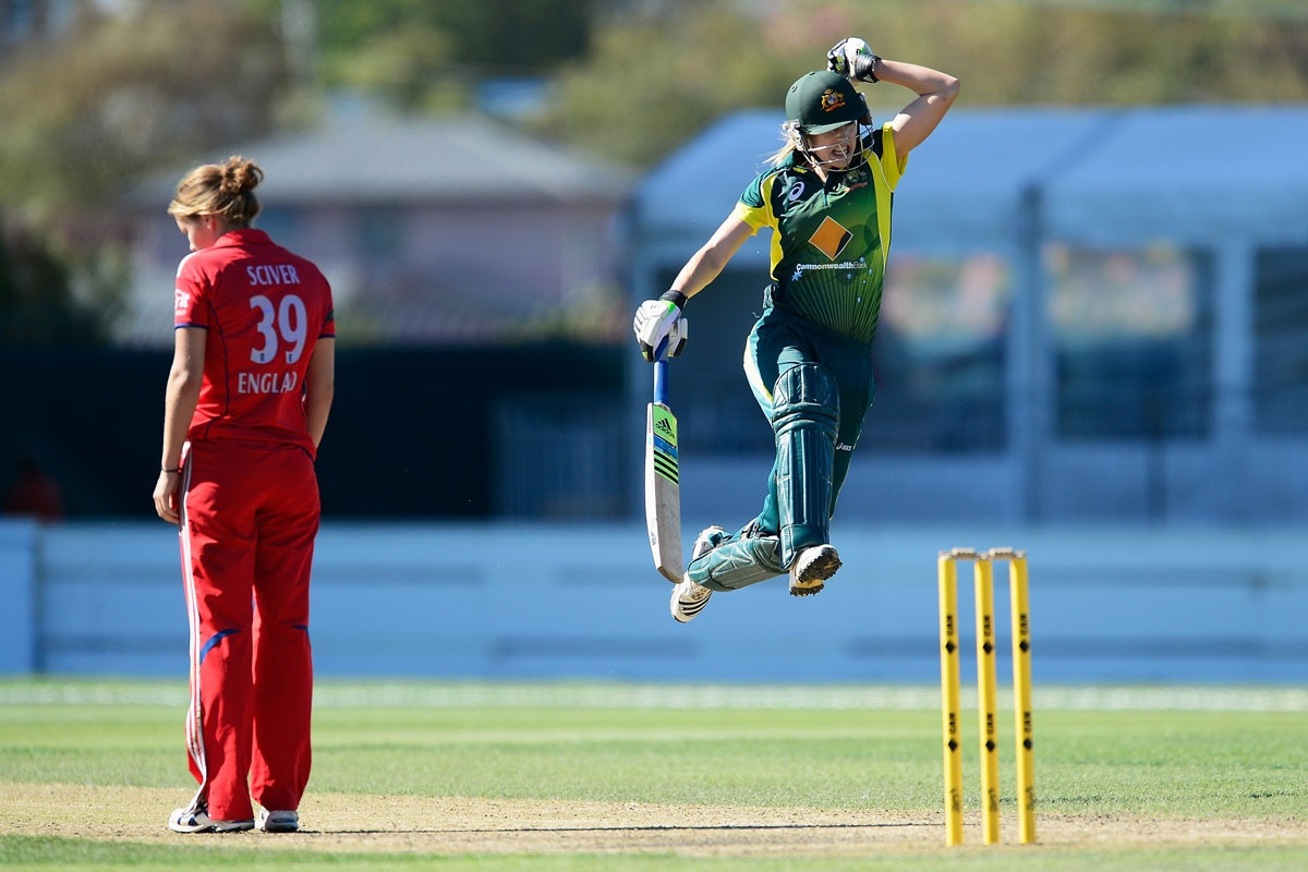 Ellyse Perry jumps for joy after hitting Australia to victory.