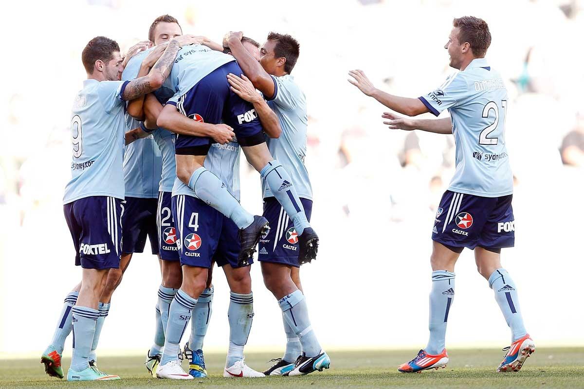 Alessandro Del Piero is congratulated by Sydney FC teammates.