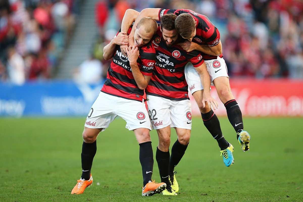 Wanderers players Aaron Mooy, Dean Heffernan and Shannon Cole celebrate.