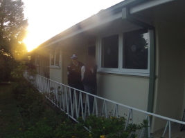 A person is arrested by police during a raid in the Blue Mountains