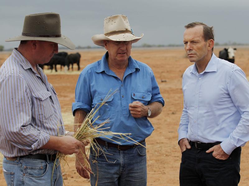 Tony Abbott (R) speaks with graziers in Bourke, NSW