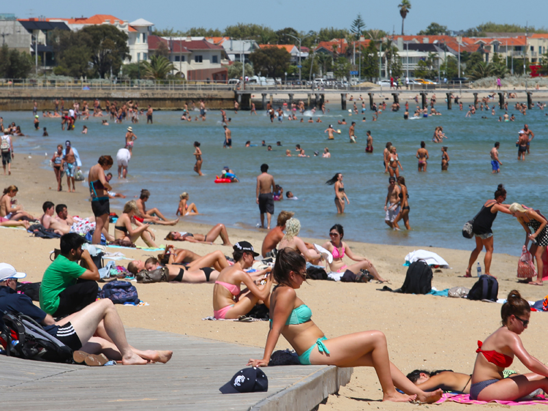 Bathers try to cool off in the hot weather at St Kilda beach