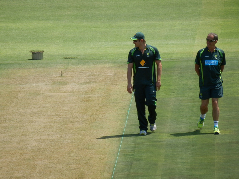Shane Watson and Australia's team doctor inspect the pitch