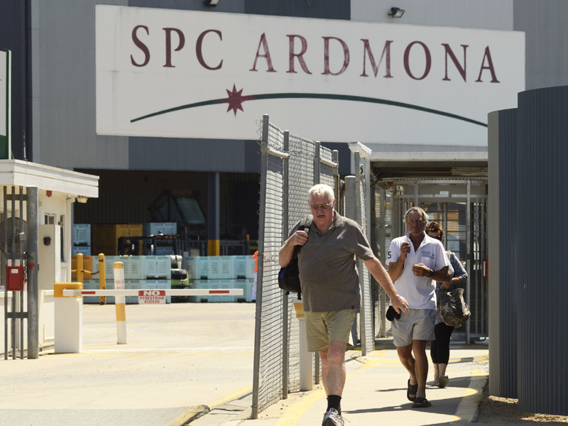 Employees leave the SPC Ardmona factory in Shepparton, Victoria